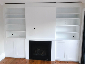Custom Made Entertainment Unit with Book Shelves above Fire Place